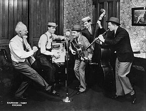 Hoosier Hot Shots - The Hoosier Hot Shots with Uncle Ezra (announcer Pat Barnett at left) publicity photo for the National Barn Dance, 1935