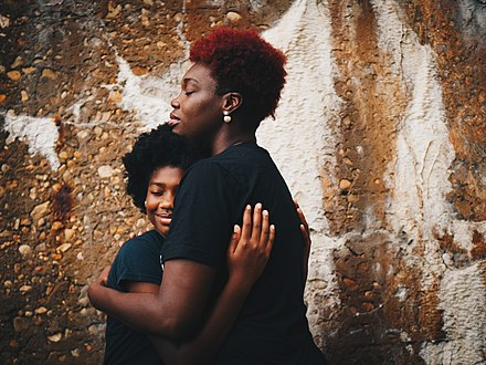 Social connection involves feeling loved, cared for, and valued, and is as important to our well-being as food or water. Hug african american women.jpg