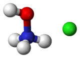 Ball-and-stick model of a hydroxylammonium cation (left) and a chloride anion (right)
