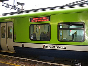 "Iarnród Éireann - A 29000 Class Commuter train at Tara Street Station, Dublin, in 2006. The LED display is showing ""Destination: Pearse Station"" in Irish."