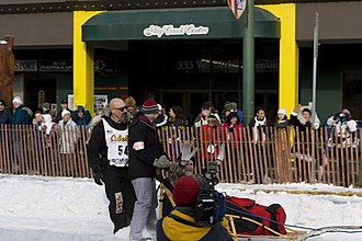 Paul Ellering - Ellering on Fourth Avenue in Anchorage during the ceremonial start of the 2006 Iditarod.