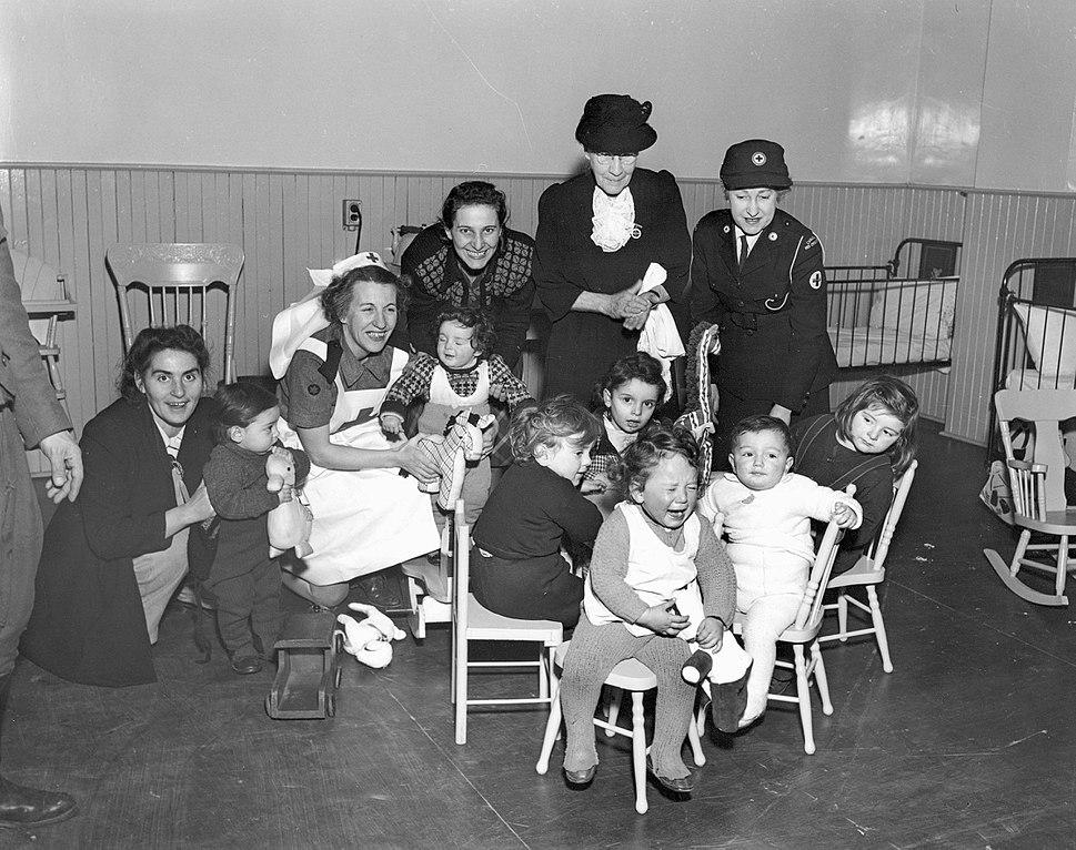 Immigrant Children with Red Cross Port Workers, Pier 21, Halifax, Nova Scotia, Canada, 1948
