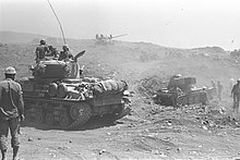 220px-Israeli_tanks_advancing_on_the_Gol