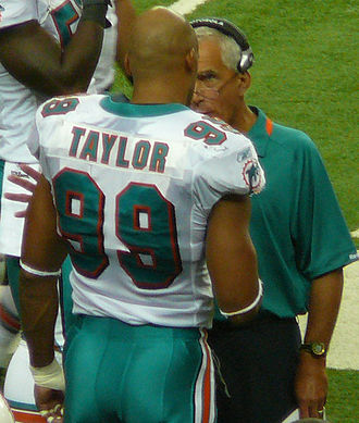 Paul Pasqualoni - Pasqualoni (right) with Miami Dolphins linebacker Jason Taylor in 2009.