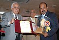 Kapil Sibal giving away the National Award for Science Communication for the year 2008 to Shri G.S. Unni Krishnan Nair from Trivandrum, for outstanding efforts in science & technology popularization among children.jpg