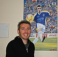Kevin McNaughton with painting.jpg