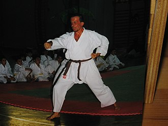 Kiai - A man using kiai while performing a kata