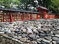 Koyasu Stones in Yunokata Shrine and fence of Umi Hachiman Shrine.JPG