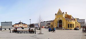 Kuopio - Kuopio Market Place with the Market Hall in foreground and the City Hall in the background