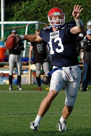 A Quarterback throwing a Pass. (Scott Pendarvi...