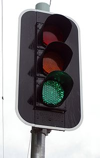 "Traffic lights display green to indicate ""go ahead""."