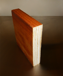 A short piece of laminated veneer lumber cut in section to show composing multiple layers of thin wood