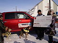 Lance Mackey poses with winner's check and truck (4446498410).jpg