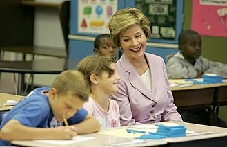 Laura Bush - The First Lady shares a laugh with fifth graders in Des Moines, Iowa, 2005