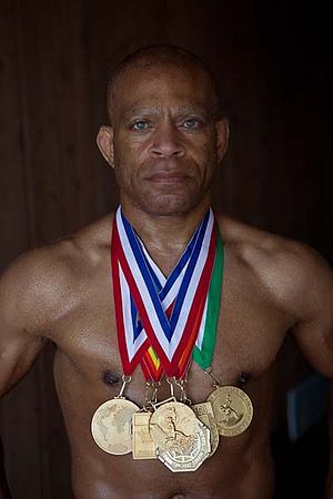 Leroy Kemp - Lee Kemp with his 7 Gold Medals earned during his wrestling career