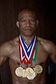 Lee Kemp with his 7 gold medals.jpg