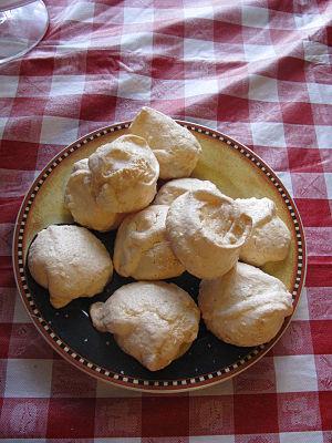 Lemon meringue cookies on checkered tablecloth...