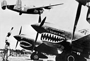 Liberator bomber crosses the P-40 fighter planes
