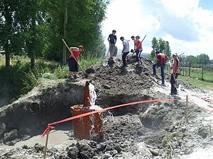 Lichk - Residents attempt to repair damage to the village spring