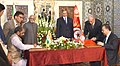 M. Hamid Ansari and the Prime Minister of Tunisia, Mr. Habib Essid witnessing the signing of MoUs between the Minister of State for Chemicals & Fertilizers.jpg
