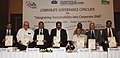 "M. Veerappa Moily releasing a brochure, at the Corporate Governance Conclave on ""Integrating Sustainability into Corporate DNA, in New Delhi on August 12, 2011. The Chief Minister of Delhi, Smt. Sheila Dikshit is also seen.jpg"