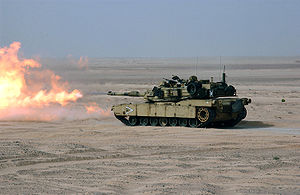 Rheinmetall 120 mm gun - An M1A1 Abrams, firing its US built M256 120 mm tank gun