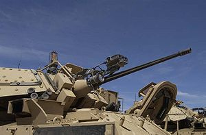 M242 Bushmaster - The Enhanced M242 on the M2 Bradley (the top-mounted metal box and spotlight are MILES training attachments, not part of the gun system). Note the fluted barrel.