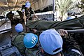MINUSTAH peacekeepers load an ijured person into a truck (12 january 2010).jpg