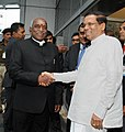 Maithripala Sirisena being received by the Minister of State for Road Transport & Highways and Shipping, Shri P. Radhakrishnan on his arrival, at Indira Gandhi International Airport, in New Delhi on February 15, 2015.jpg