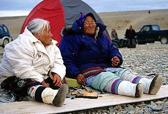 Inuit cuisine - Inuit elders eating Maktaaq