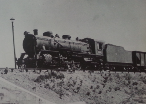 China Railways JF2 - A Mikani class locomotive in service with Mantetsu, with a Ta6 class coal hopper behind it.