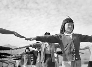 Internees practicing calisthenics at Manzanar War Relocation Center