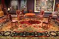 Maurice dufrene, sedie, poltroncine e tavolino, francia 1912, su tappeto gobelins di rené binet (1910) 01.JPG
