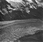 McCarty Glacier, tidewater glacier and hanging glaciers on the mountainsides, and icefall, September 4, 1977 (GLACIERS 6632).jpg