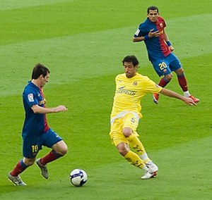 Joan Capdevila - Capdevila (right) attempting a tackle on Lionel Messi