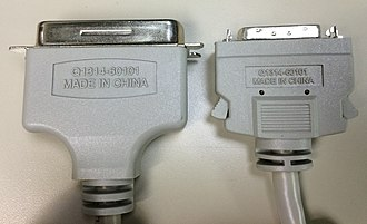 Micro ribbon connector - Mini-Centronics 36 pin male connector (right) with Micro ribbon 36 pin male Centronics connector (left).