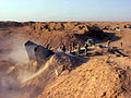 Mig25 buried in iraq.jpg