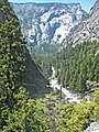 Mist Trail along the Merced River. View west, looking down down from the lip of Vernal Falls. The river and trail continue to the right at the end of the canyon, where Illilouette Creek joins in coming from the left. Ha - panoramio.jpg