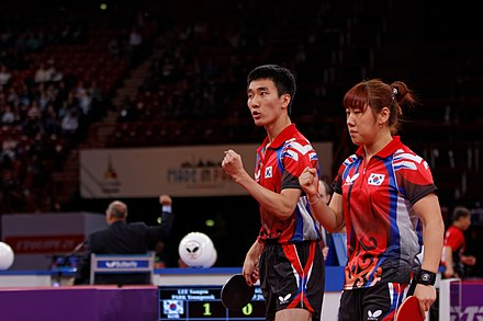 A mixed-sex table tennis team celebrating a point Mondial Ping - Mixed Doubles - Semifinals - 07.jpg