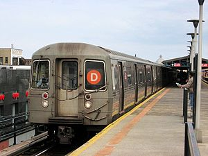 D (New York City Subway service) - A train made of R68 cars in D service at Bay Parkway, bound for Manhattan and the Bronx.