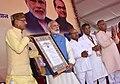 "Narendra Modi being presented a memento by the Chief Minister of Madhya Pradesh, Shri Shivraj Singh Chouhan, at the launching ceremony of the ""Gram Uday se Bharat Uday"" Abhiyan, in Mhow, Madhya Pradesh.jpg"