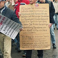 "Protesters against the Wehrmacht Exhibition in 2002. The exhibition detailed the war crimes of the Wehrmacht. One of the posters reads: ""Our fathers were not criminals."""