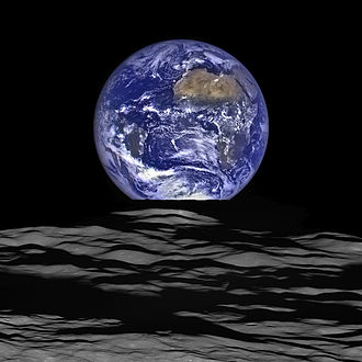 Earthrise - The Earth straddling the limb of the Moon, as seen from above Compton crater. Taken by the Lunar Reconnaissance Orbiter.