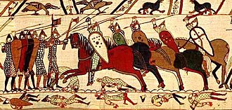 Lance - Norman cavalry attacks the Anglo-Saxon shield wall at the Battle of Hastings as depicted in the Bayeux Tapestry. The lances are held with a one-handed over-the-head grip.
