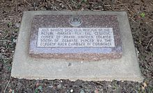 "Stone marker with embedded bronze disc; marker reads ""This bronze disc is a replica of the actual marker for the geodetic center of North America, located south of Osborne. Placed by the Osborne Area Chamber of Commerce."""