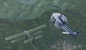 "Battle of Lima Site 85 - ""An Air Combat First"" – CIA painting of Air America helicopter engaging 2 VPAF An-2 biplanes"