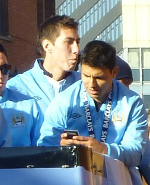 Costel Pantilimon - Pantilimon (left) with Sergio Agüero on Manchester City's Premier League victory parade, May 2012