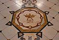 Paviment de la sala roja amb les inicials del marqués de Dosaigües.JPG