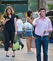 People using cellphones on a street in New York.jpg