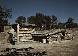 Homesteader with dugout house in Pie Town, 1940 photograph by Russell Lee.